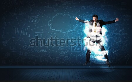 Stock photo: Happy business man jumping with storm cloud around him