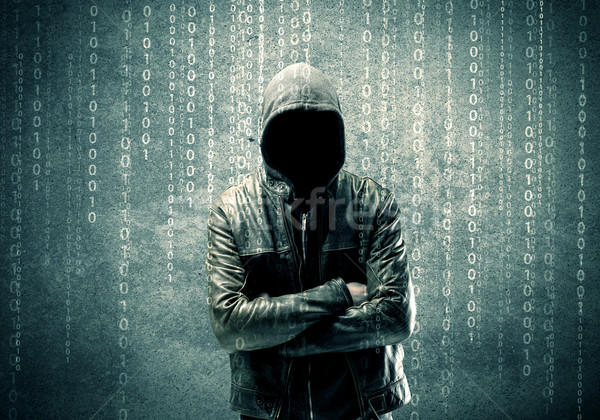 Stock photo: Angry mysterious hacker with numbers