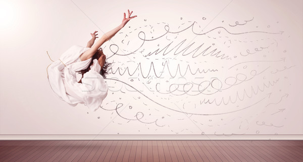 Pretty woman jumping with hand drawn lines and arrows come out Stock photo © ra2studio