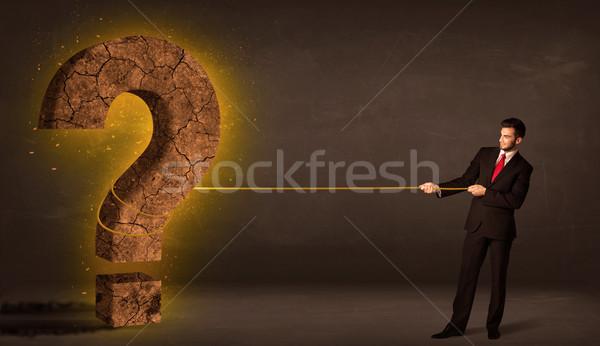 Uomo d'affari grande solido punto di domanda pietra Foto d'archivio © ra2studio