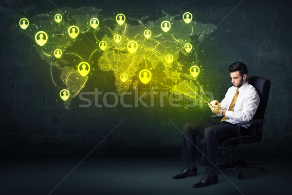 Businessman in office with tablet and social network world map Stock photo © ra2studio