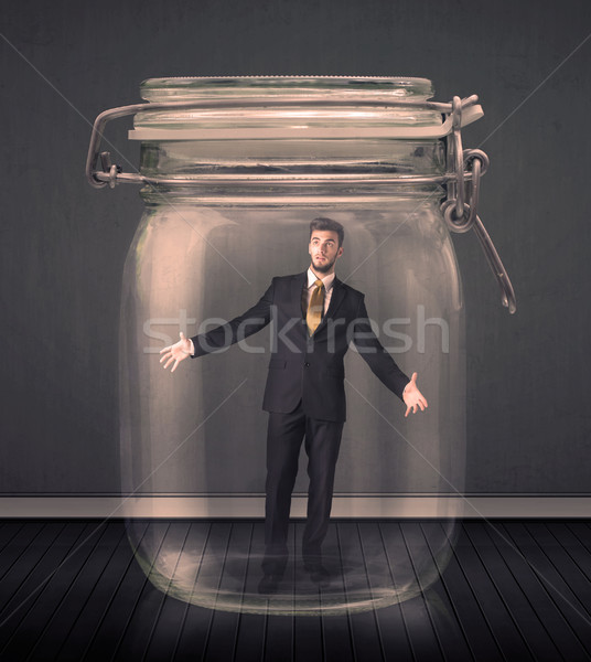 Businessman trapped into a glass jar concept Stock photo © ra2studio