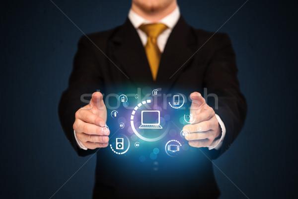 holding digital media icons Stock photo © ra2studio