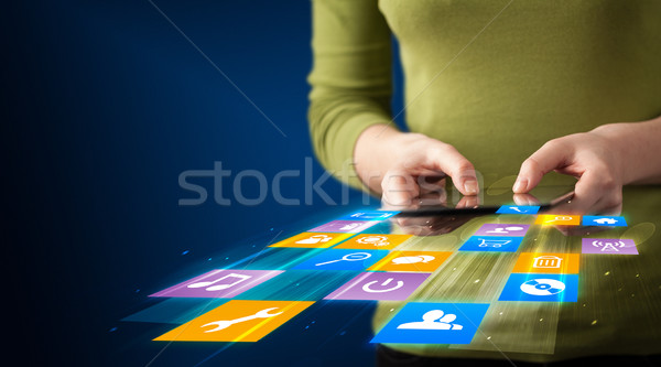 Stock photo: Hand holding tablet device with media application