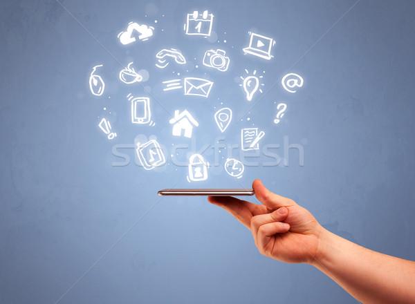 Mano tablet telefono icone Foto d'archivio © ra2studio