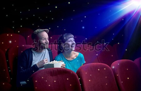 Lovely couple watching 3D movie Stock photo © ra2studio
