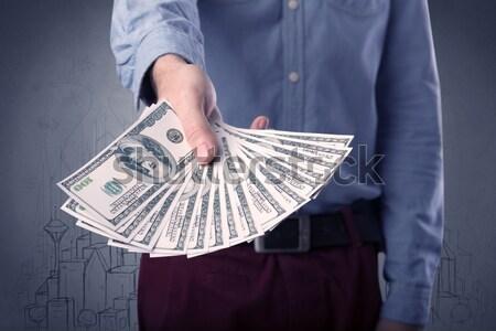 Geschäftsmann halten Geld jungen groß Betrag Stock foto © ra2studio