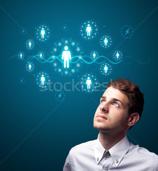 Businessman pressing modern social type of icons Stock photo © ra2studio