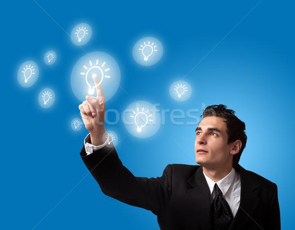 Adam dokunmatik ekran düğme iş adamı dijital Stok fotoğraf © ra2studio