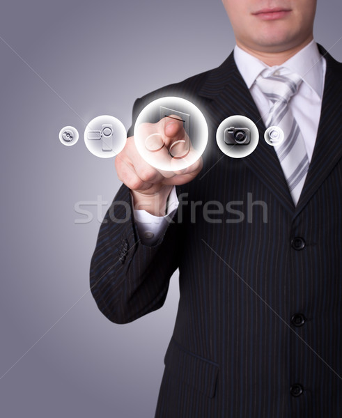 Man pressing media player button Stock photo © ra2studio