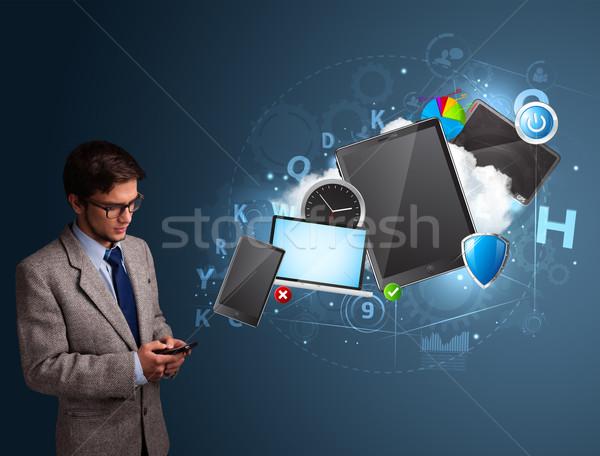 Attractive boy browsing on his smartphone Stock photo © ra2studio