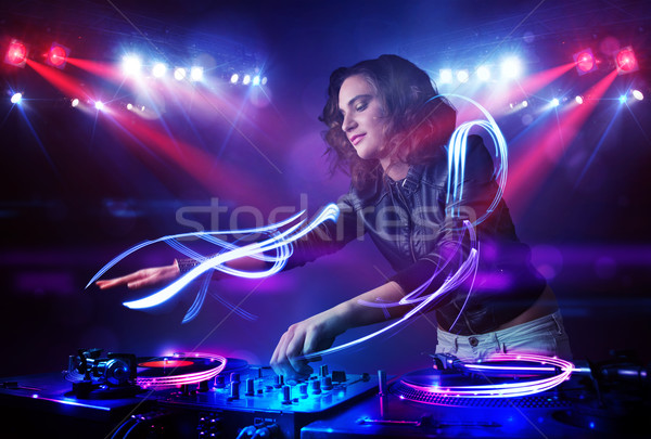 Disc jockey nina jugando música luz Foto stock © ra2studio
