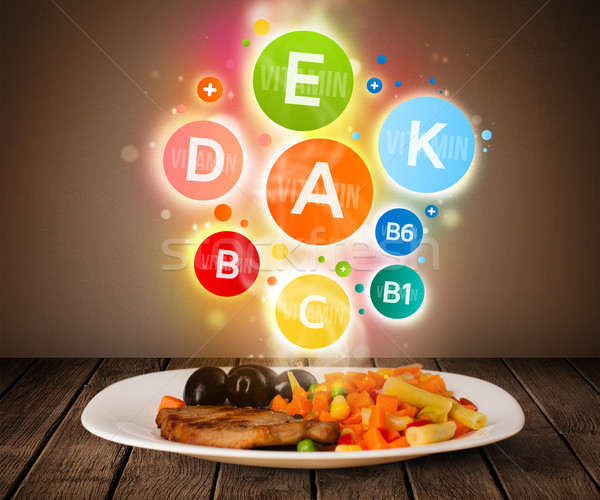 Food plate with delicious meal and healthy vitamin symbols Stock photo © ra2studio