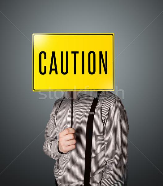Geschäftsmann halten Vorsicht Zeichen stehen gelb Stock foto © ra2studio