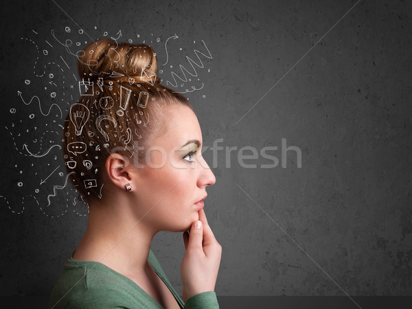 Young girl thinking with abstract icons on her head Stock photo © ra2studio