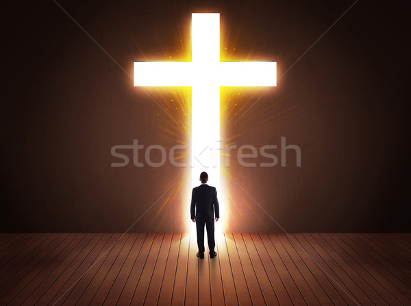 Man looking at bright cross sign  Stock photo © ra2studio