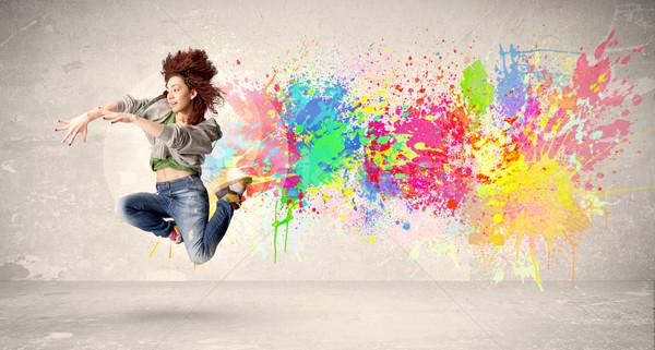 Glücklich Teenager springen farbenreich Tinte splatter Stock foto © ra2studio