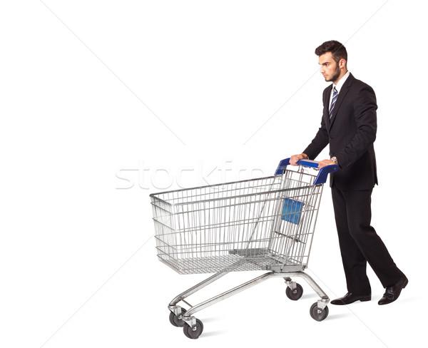 Empresario cesta de la compra empujando aislado traje mercado Foto stock © ra2studio