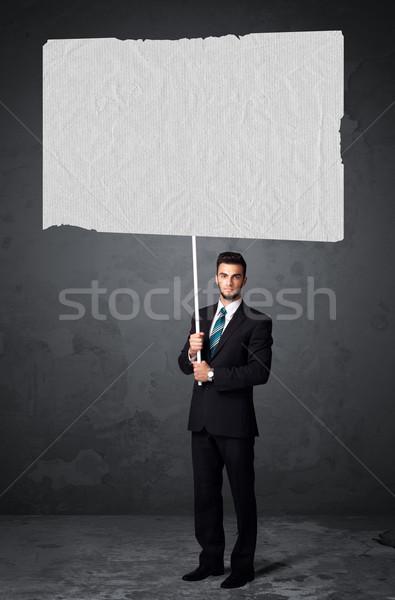 бизнесмен буклет бумаги молодые большой Сток-фото © ra2studio