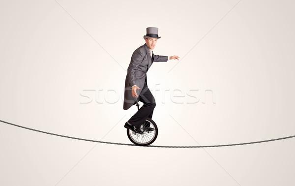 Extrême homme d'affaires équitation corde affaires Photo stock © ra2studio