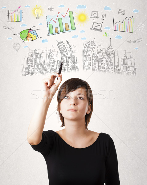 Stock photo: Cute woman sketching city and graph icons
