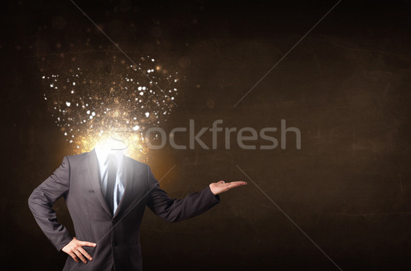 Stock photo: Business man with glowing exploding head
