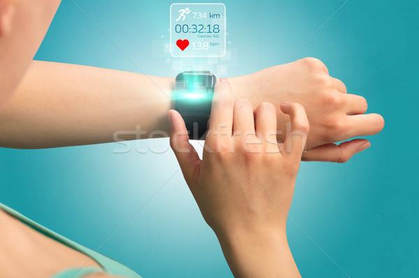 Hand with smartwatch Stock photo © ra2studio
