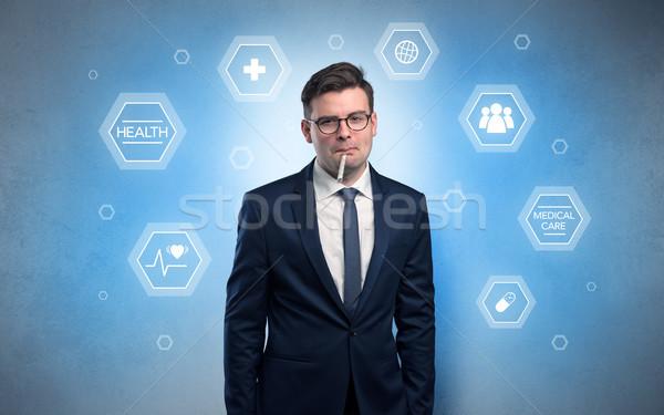 Malade affaires soins médicaux jeunes pilules homme Photo stock © ra2studio