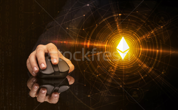 Hand using mouse with cryptocurrency concept Stock photo © ra2studio