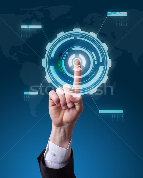 Hand voortvarend knop futuristische interface Stockfoto © ra2studio