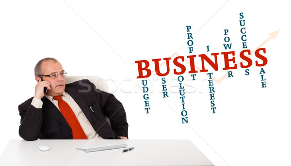 businessman sitting at desk and making phone call with word cloud, isolated on white Stock photo © ra2studio