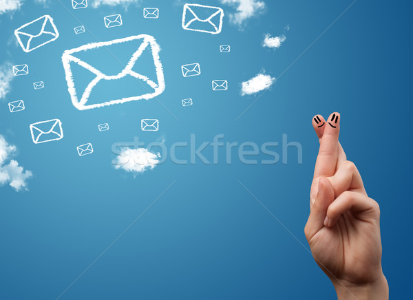 Happy smiley fingers looking at mail icons made out of clouds Stock photo © ra2studio