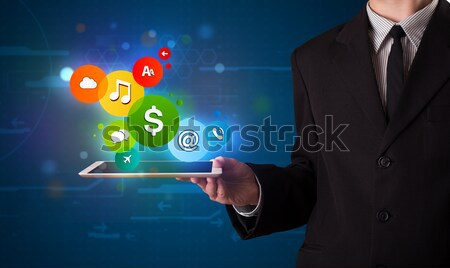 Businessman presenting colorful modern signs Stock photo © ra2studio