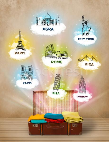 Tourist suitcase with famous landmarks around the world Stock photo © ra2studio