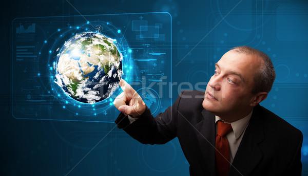 бизнесмен прикасаться 3D земле панель Постоянный Сток-фото © ra2studio