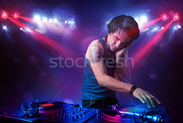 Teenager dj mixing records in front of a crowd on stage Stock photo © ra2studio
