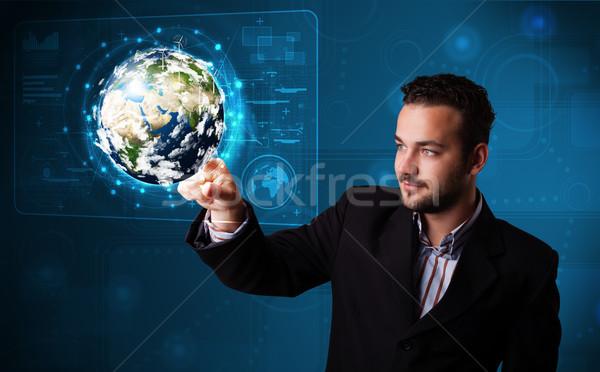 Fiatal üzletember megérint 3D Föld panel Stock fotó © ra2studio