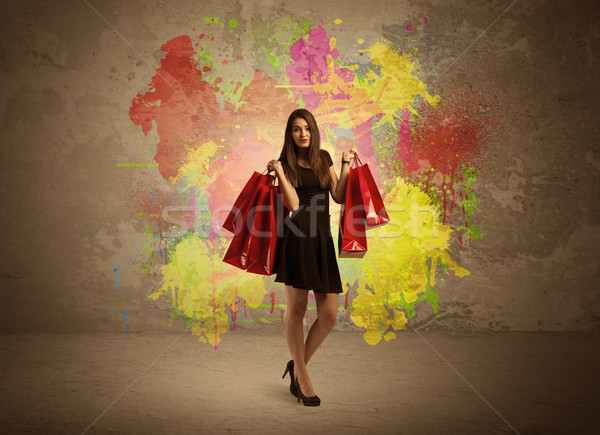 Girl with shopping bags and paint splatter Stock photo © ra2studio