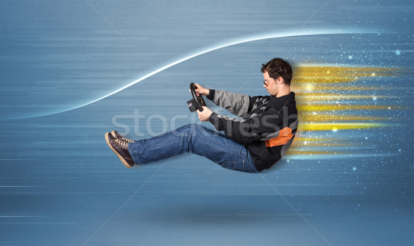 Young man driving in imaginary fast car with blurred lines  Stock photo © ra2studio