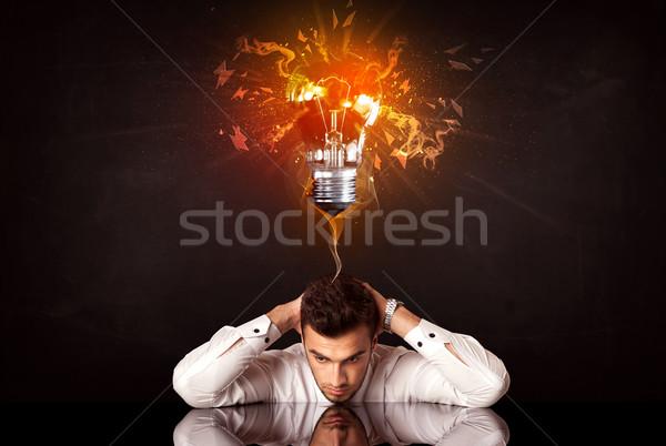 Empresario sesión idea bombilla deprimido Foto stock © ra2studio