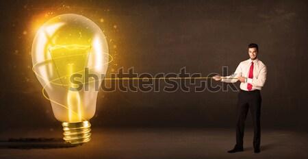 Stock fotó: üzletember · húz · nagy · fényes · izzó · villanykörte