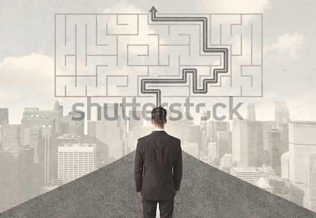 Businessman looking at road with maze and solution Stock photo © ra2studio