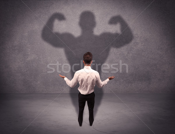 Successful businessman with strong shadow Stock photo © ra2studio