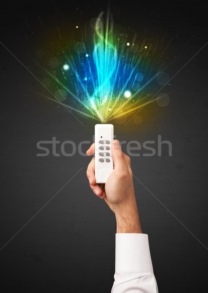 Hand with remote control and explosive signal Stock photo © ra2studio