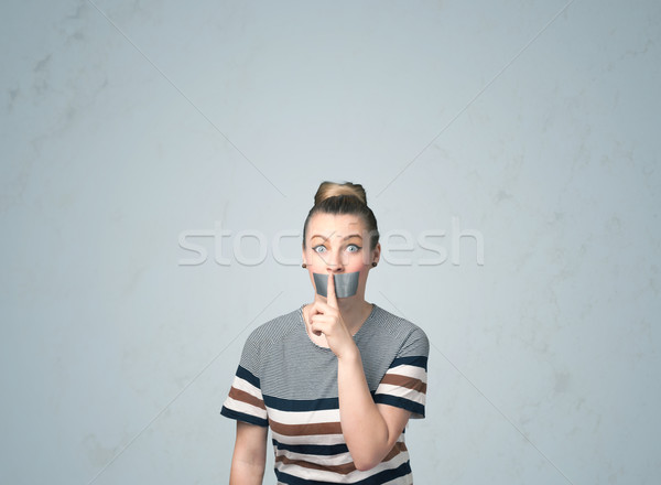 Young woman with glued mouth Stock photo © ra2studio