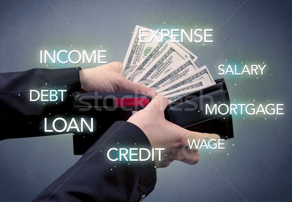 Işadamı el dışarı para cüzdan dolar Stok fotoğraf © ra2studio