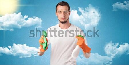 Zonnige huishoudster oranje handschoenen bewolkt mannelijke Stockfoto © ra2studio