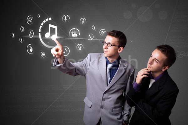 üzletember kisajtolás virtuális média gombok Stock fotó © ra2studio