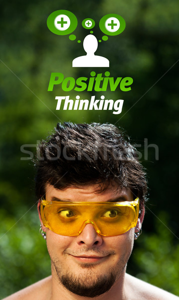 Young head looking at positive negative signs Stock photo © ra2studio