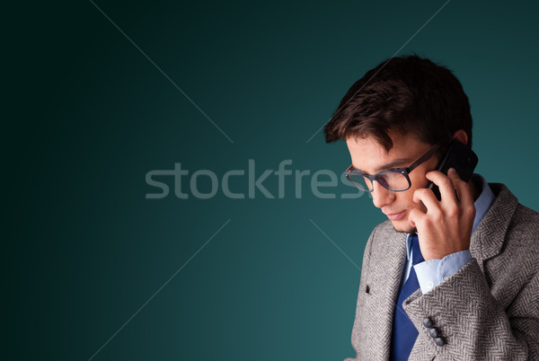 Young man making phone call with copy space Stock photo © ra2studio